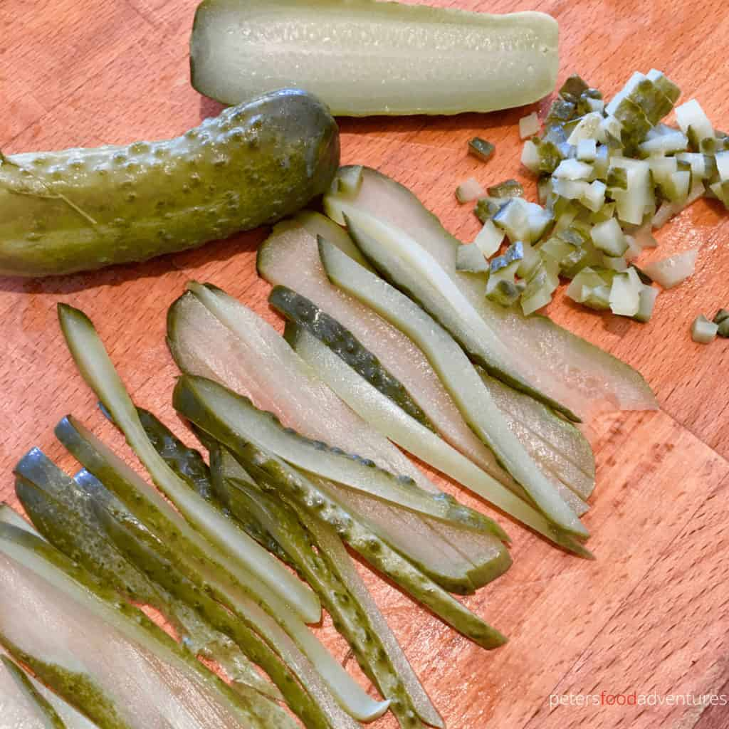 slicing pickles on a cutting board