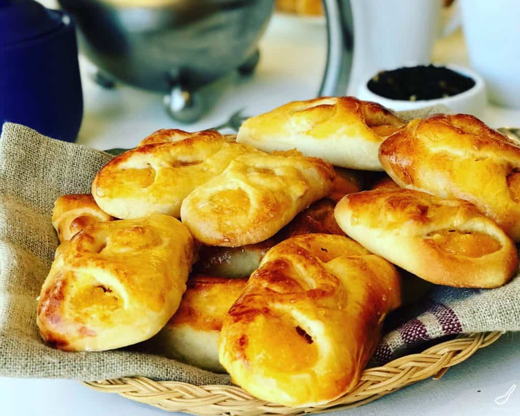 Sweet and delicious, Apricot Piroshki are a tasty yeast dough pastry made from dried apricots (or prunes). Delicious from the old country! (Пирожки с абрикосами)