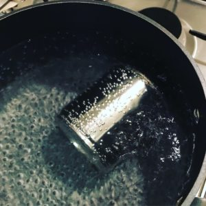 Condensed milk can in boiling water