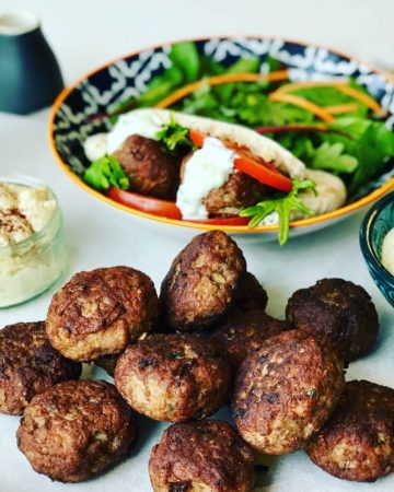 Lamb Patties in Pita Bread with salad is delicious summer meal or appetizer.It's like a small lamb burger, lamb meatball or lamb rissoles. Perfect as a lamb pita pocket or a lamb slider for lunch.