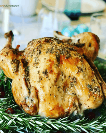 A deliciously crispy butter basted turkey with fresh thyme and garlic. A perfect Thanksgiving or Christmas Turkey! Butter Basted Roast Turkey Recipe