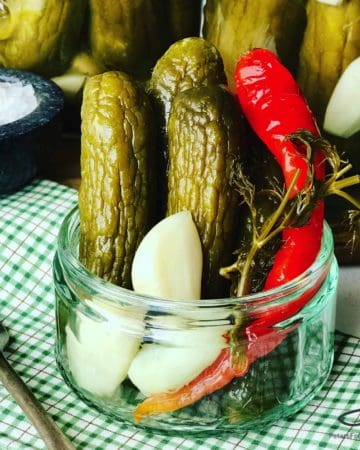 A classic Russian Pickles recipe with lots of garlic, dill and spices, naturally crunchy. Home canning is easier than you think. Canning Dill Pickles is the best way to preserve your cucumbers. Homemade Dill Pickles