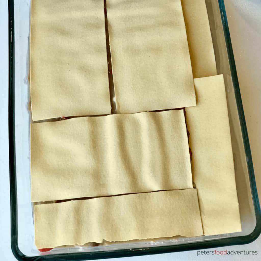 layering seafood lasagna sheets