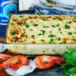 This Easy Seafood Lasagna is made with mushroom soup, white wine, shrimp, scallops and imitation crab. Rich and creamy family dinner favorite.
