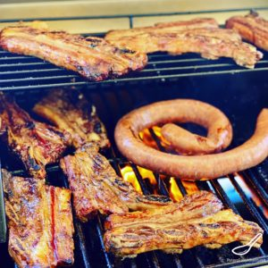 Bbq meat cooking on a grill