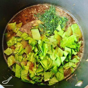Fresh chopped Sorrel in a soup pot