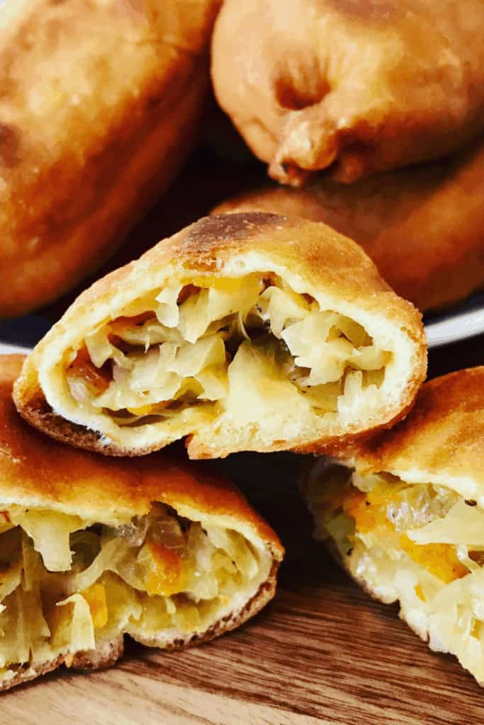 Fried Piroshki with cabbage, close up of filling