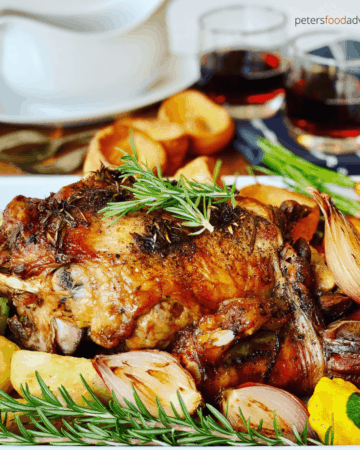 Slow Roast Leg of Lamb recipe, perfect for a Sunday Roast, an Easter Lamb lunch, or for dinner tonight. Roast Lamb with pierced with fresh rosemary and garlic, roasted with vegetables.