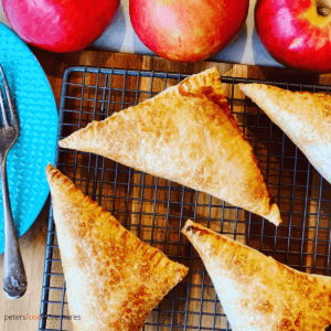 Apple Turnovers with Puff Pastry are an autumn favorite, easy to make apple hand pies. Perfect way to use up apples during harvest. Made with puff pastry, freeze them for later, or drizzle them with a cream cheese icing. Perfect for breakfast or for dessert!