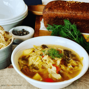 Instant Pot Cabbage Soup - Russian Style! A hearty meal made with Beef Bone Broth, cabbage, sauerkraut, potato and dill. A one pot comfort food dinner your whole family will love. Serve with sour cream and dark rye bread.