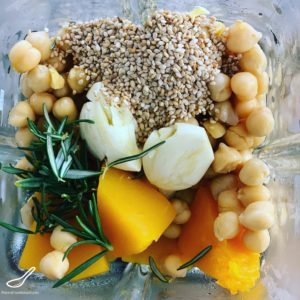 Mixing Chickpeas, Pumpkin, Garlic, Sesame Seeds and Rosemary in a blender