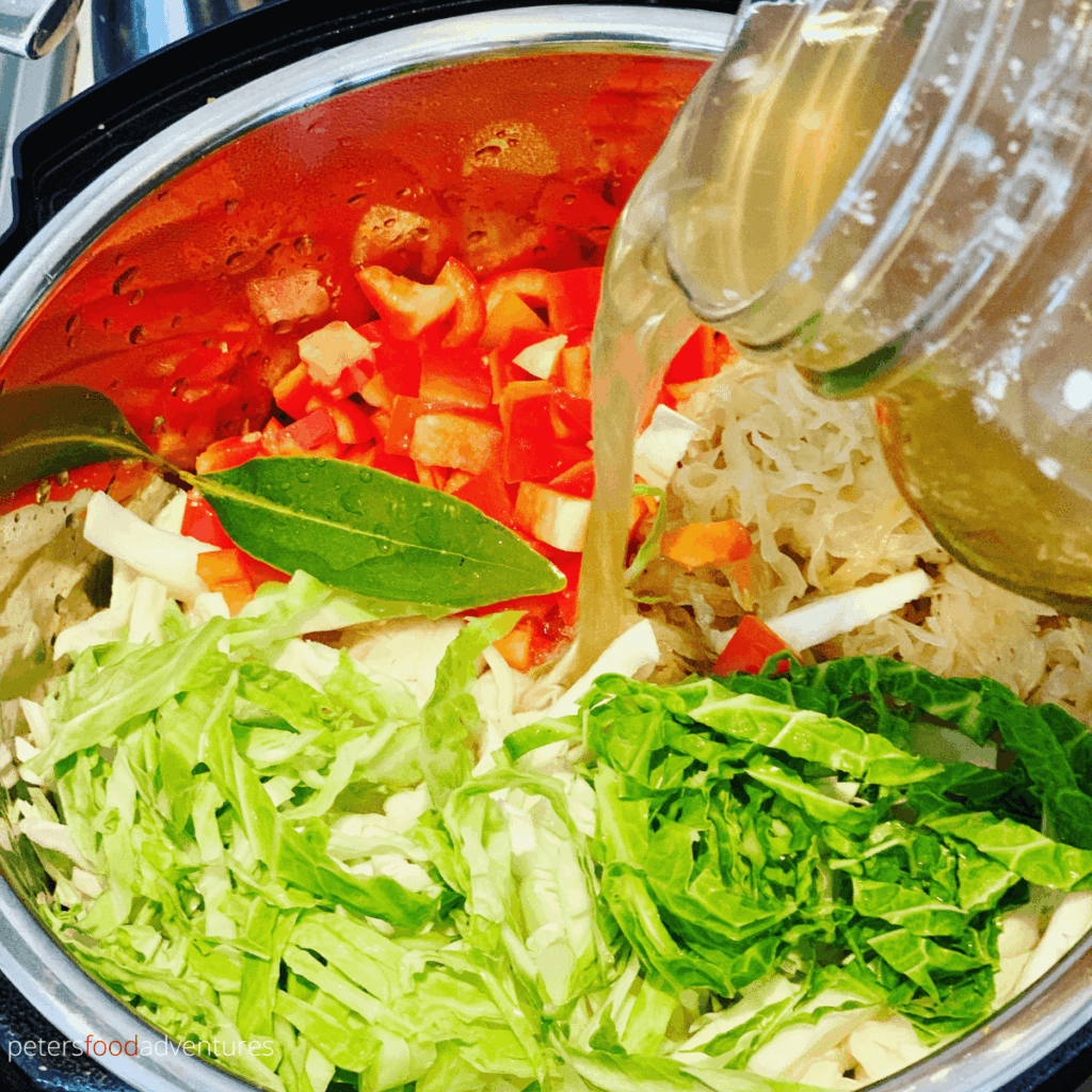 making cabbage soup in instant pot, pouring broth over vegetables