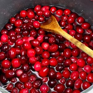 Cranberries cooking in a saucepan