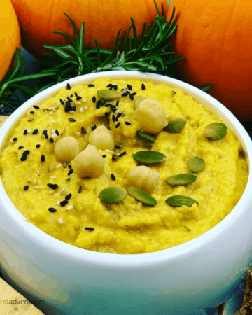 Easy Pumpkin Hummus is healthy appetizer and perfect for fall or Thanksgiving. Made in minutes, with pumpkin, chickpeas, garlic and rosemary. A vegan savory dip that everyone will enjoy.