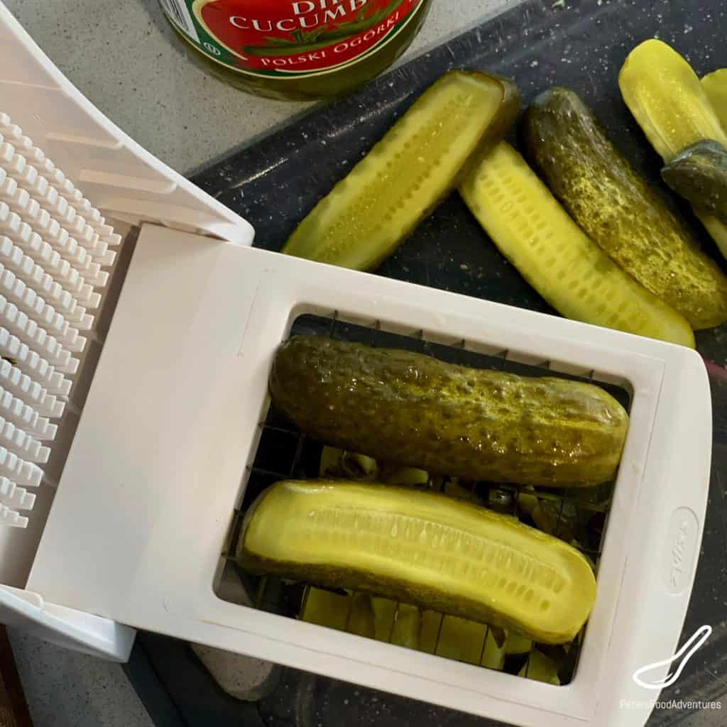 Slicing pickles in a chopper