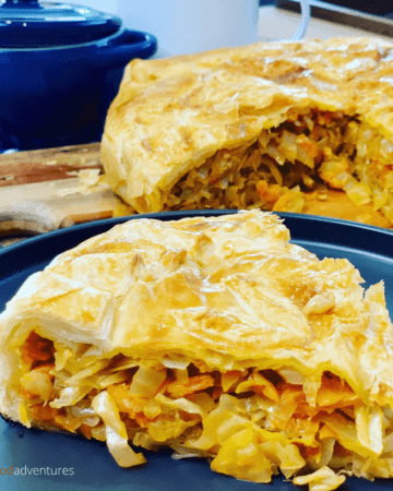 A Russian Cabbage Pie that is easy to make using a puff pastry shortcut. Stuffed with butter braised cabbage. A tasty vegetarian meal that's perfect for lunch or dinner!