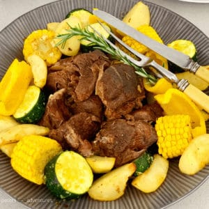 A foolproof Greek Instant Pot Lamb recipe with rosemary, garlic, oregano, thyme, lemon and red wine. An easy pulled lamb or tender roast dinner recipe, a pressure cooker favorite with a lamb gravy recipe!
