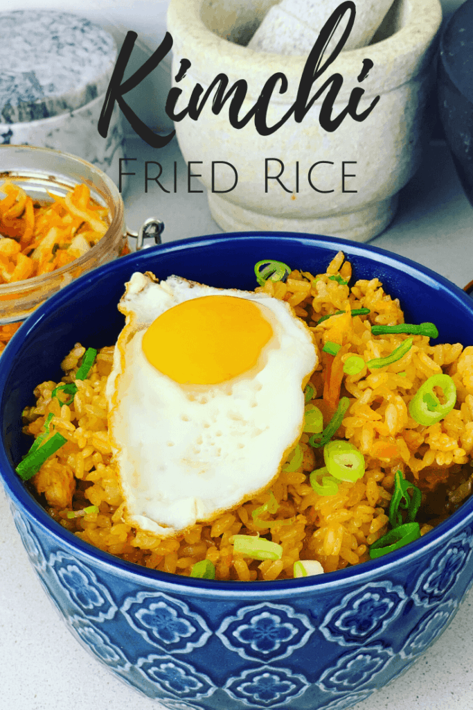 A Kimchi Fried Rice recipe that will feed a family. Made with chicken, but often made as a vegetarian recipe. So easy to make, packed with flavor, and can be done in 30 minutes. You want want boring fried rice after eating this delicious recipe! Kimchi Bokkeumbap.