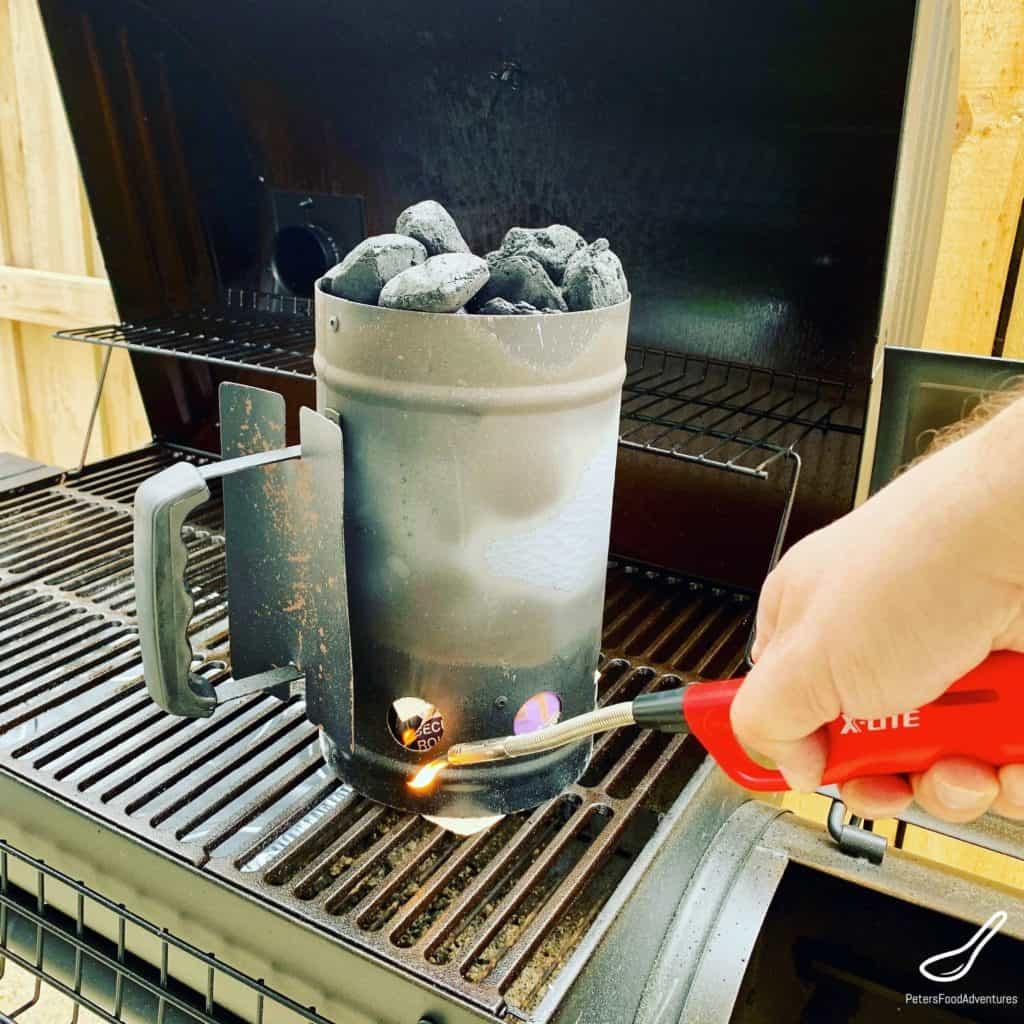 Lighting charcoal for a smoker