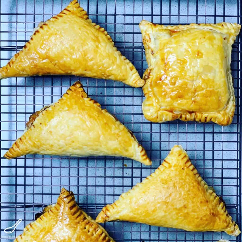 Turkey turnovers cooling on a wire rack