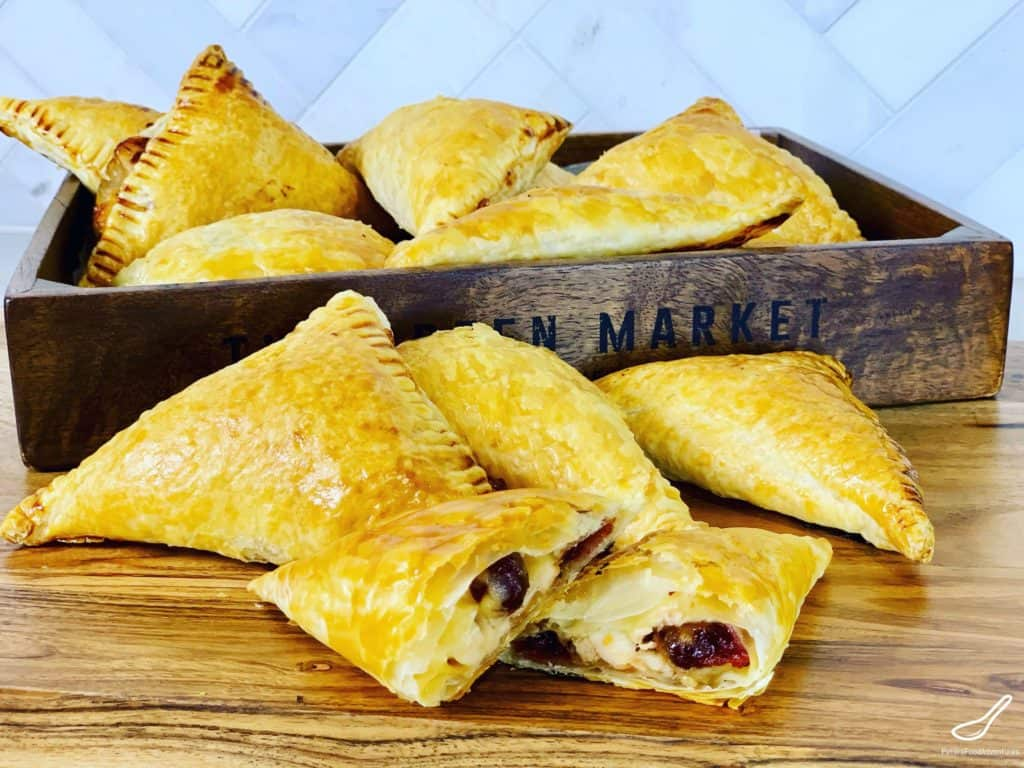 Delicious Leftover Thanksgiving turkey turnovers with cranberries, swiss cheese and a sprinkle onions. The only turkey leftovers recipe you'll need these holidays