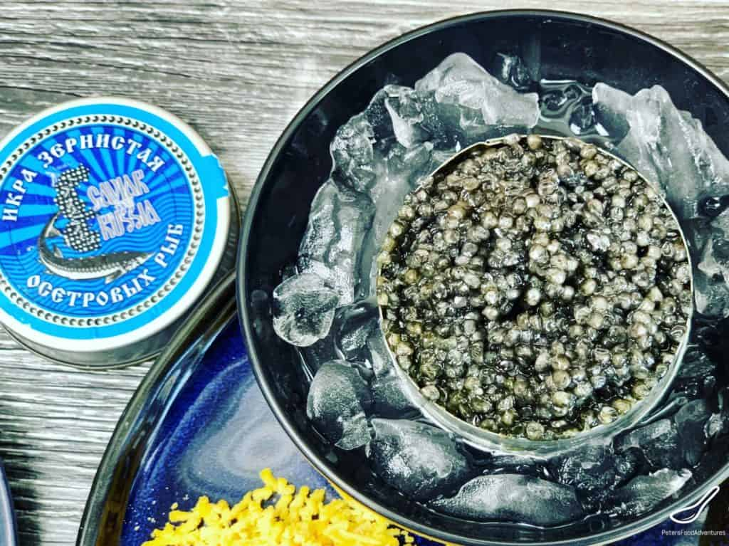 open tin of black Russian caviar on ice, икра