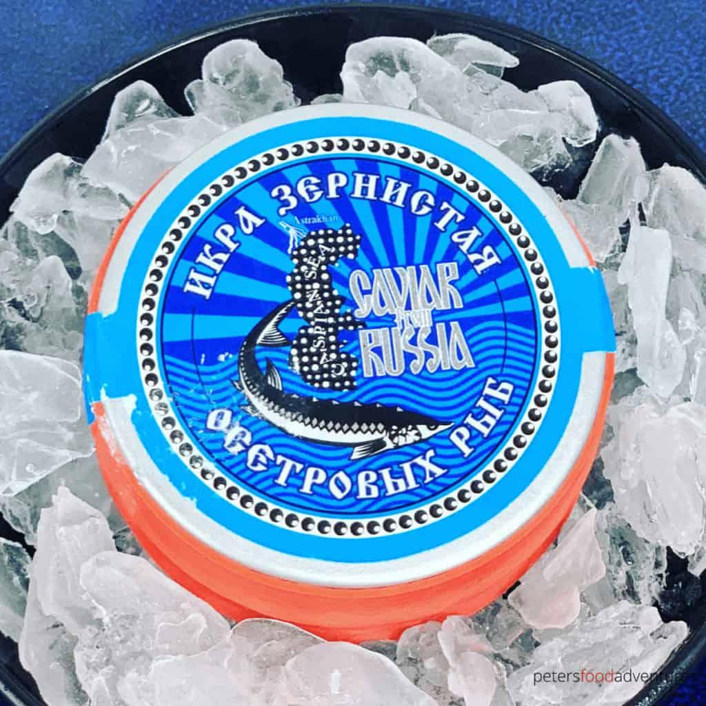russian black caviar in a tin on ice