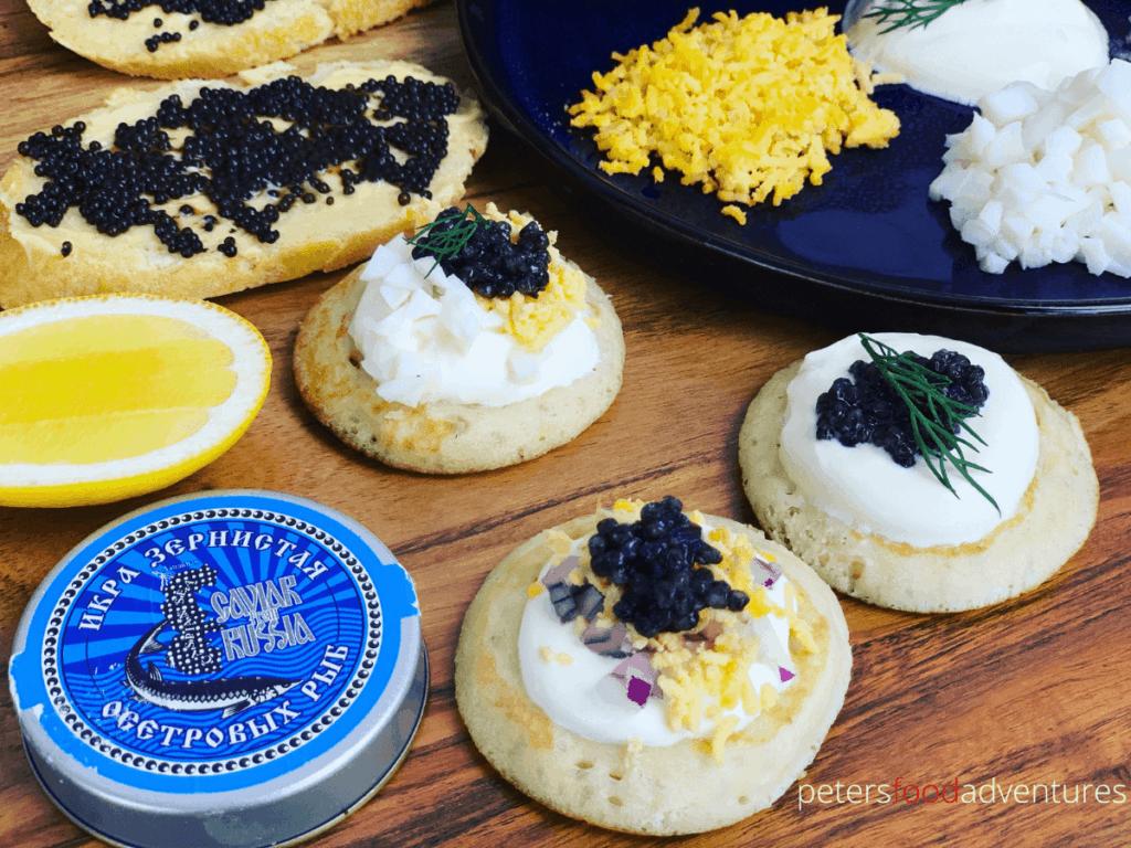 black caviar on small blinis