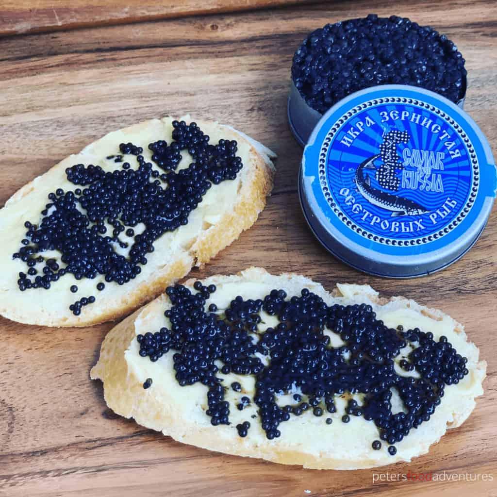 black caviar spread on buttered bread