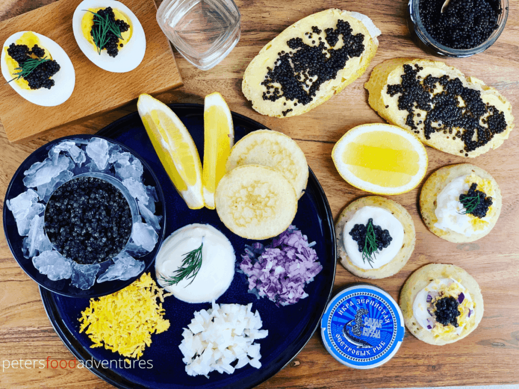 caviar platter board with blinis, breads and eggs