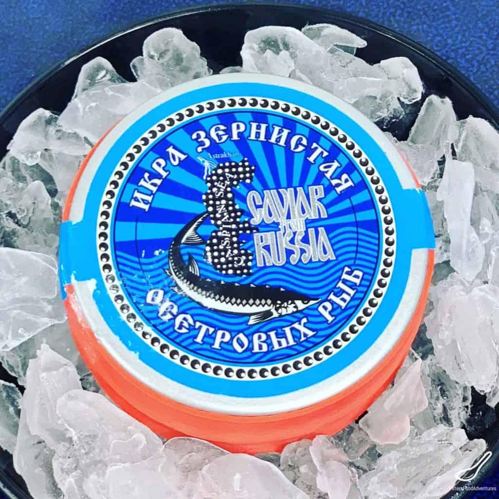 tin of Russian caviar on ice