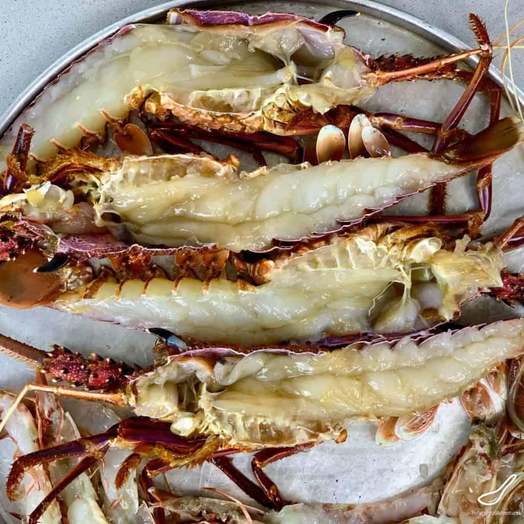 Rock lobsters sliced in half lengthways