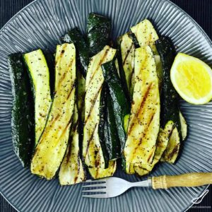 An easy and tasty way to serve a char grilled zucchini recipe. No complicated ingredients, a simple barbecued side dish that looks a little fancy.