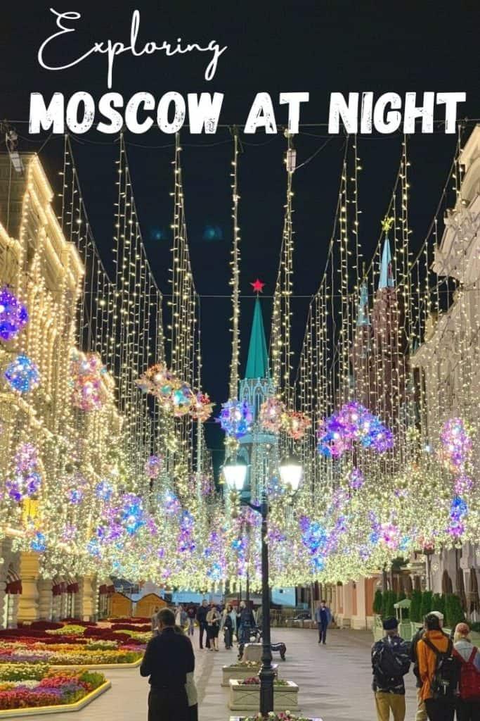 walking under Nikolskaya street's hanging lights at night