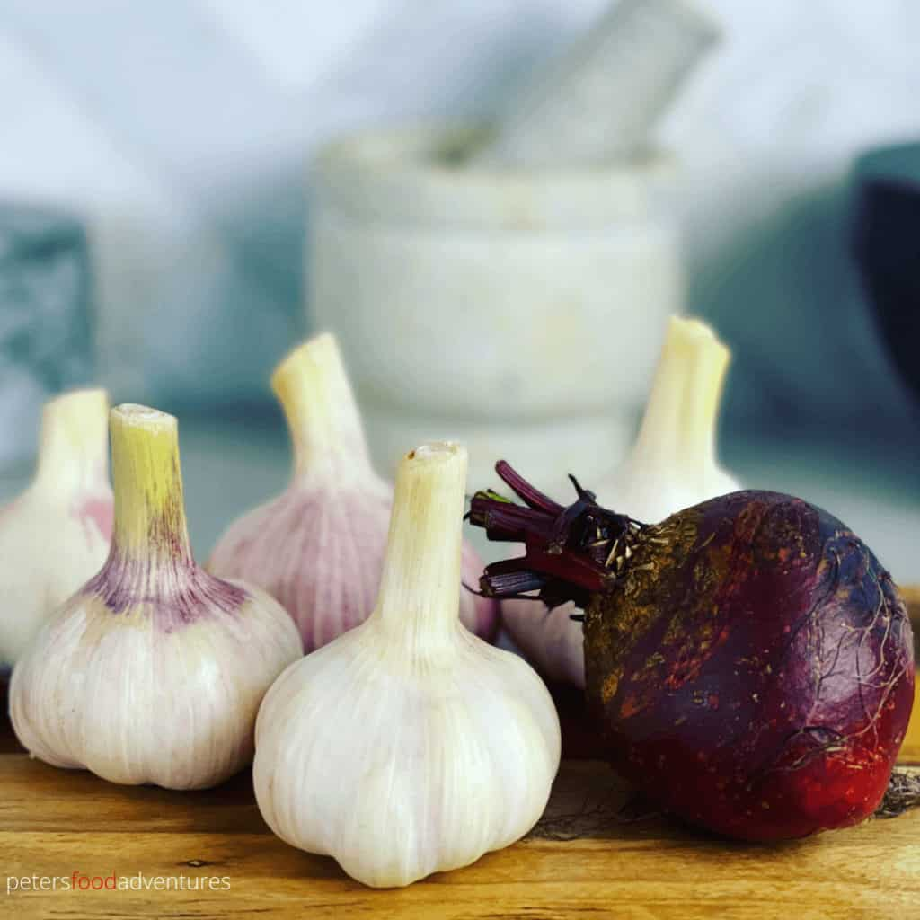 whole garlic and beets on a kitchen bench