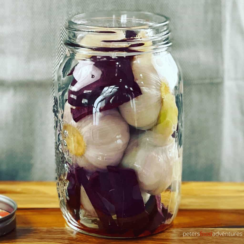 garlic with beets in a glass jar