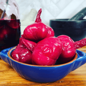 I think this is one of the coolest Pickled Garlic recipes on the internet! Bright, colorful and tasty. In Russian, we call it Marinated Garlic (Маринованный чеснок). The bright pink, almost fuchsia color of the garlic head from the pickled beets, will be the talk of the dinner table!